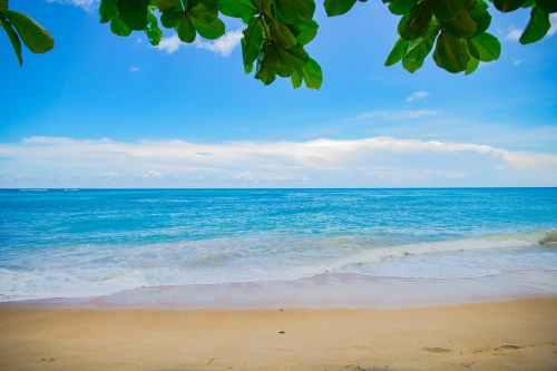 beach calm clouds horizon